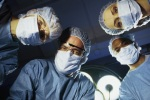 SurgeonsLookingAtPatient