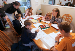 AP Photo Romeike Homeschool Family teaching their children