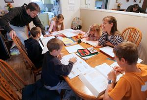 AP Photo Romeike Homeschool Family teaching their children