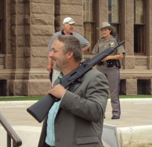 Texan Openly Carrying Rifle at Texas State Capitol