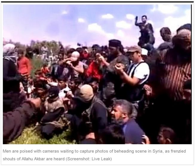 In the above photo, John McCain's new friends behead Syrian Catholic Priest Francois Murad as Syrian rebels and their families wildly cheer. These are the people  John McCain and Barack Obama will be Funding with YOUR tax dollars.