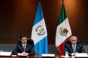 Mexican President Enrique Peña Nieto and Guatemalan president Otto Perez Molina meet 7 July 2014 in Chiapas State