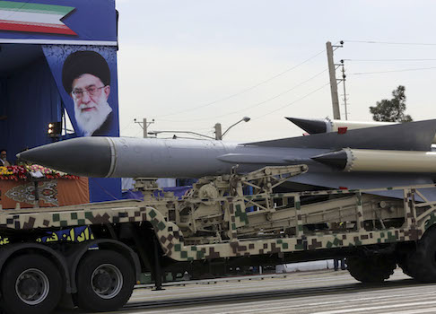 In front of a portrait of the Iranian Supreme Leader Ayatollah Ali Khamenei, a missile is displayed by the Iran's army in a military parade marking National Army Day in front of the mausoleum of the late revolutionary founder Ayatollah Khomeini just outside Tehran, Iran, Friday, April 18, 2014. Ahead of the parade, Iran's President Hassan Rouhani underscored his moderate policies and outreach to the West in a speech. (AP Photo/Vahid Salemi)