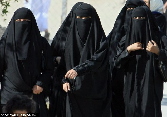saudi women required to wear the black abaya